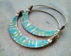 The use and importance of jewelry in primitive tribes is used as a tool for both beautification/decoration and dates back thousands of years. I just love to create and decorate myself with this style of jewelry as it has such a rich, mysterious, and magical energy to it. These bold and exotic hoop earrings remind me of the beautiful women in African tribes. With their vibrant turquoise patina eyes won't be able to turn away from you. Have fun with these enchanting adornments.  MADE TO OR...