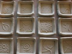 mini plates made with handmade clay stamps/molds.