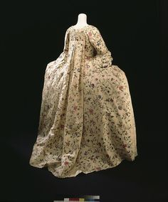 Sack back gown        Place of origin:        London, England (made)      China (silk, woven)      Date:        1760-1765 (made)      1875-1899 (made)      1875-1899 (made)      Artist/Maker:        Unknown (production)      Materials and Techniques:        Chinese painted silk, hand-sewn with silk thread, the gown and petticoat trimmed with woven silk net and silk bobbin lace, and two later decorations trimmed with 19th century green silk ribbon      Credit Line:        Purchased with the…