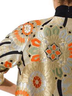 - Product Description - Measurements DETAILS Magical Karabana flowers abound, woven in gold, silver, orange and green. A very special lady in the 1960s saw the magic of this glorious textile and had t