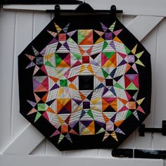 Octagon Storm at Sea mini quilt.  Interesting look with the smaller offset blocks.