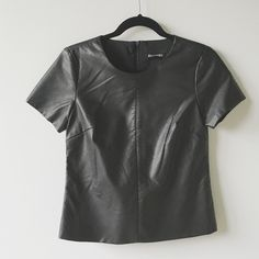"""Express Faux Leather Tee Goes with anything! This faux leather top from Express features a crew neckline and zipper back. New without tags. Measures 16"""" across and 21"""" long. Express Tops"""