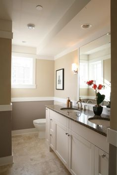 white cabinets, dark counter, two toned beige walls