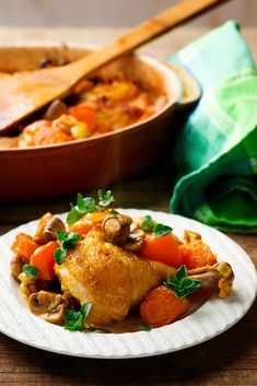 Chicken baked with mushrooms and pumpkin.