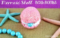 Enjoy the best bath bomb with this Mermaid Shell Bath Bombs! These bath bombs will make you imagine being on the beach somewhere, or even at the top of a rock with a yellow and blue fish and a small red crab looking up at you! Save this pin for later! Mermaid Crafts, Mermaid Diy, Mermaid Bath Bombs, Bath Boms, Best Bath Bombs, Homemade Bath Bombs, Mermaid Shell, Bomb Making, Bath Bomb Recipes