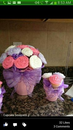 Cupcake Bouquets in flower pots. Baby shower center pieces.
