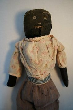 """17"""" black cloth doll embroidered face 19th C."""