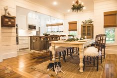 Dining and kitchen areas from @simplysoutherncottage. Custom chairs from @chairwhimsy. Jute rug. Repurposed kitchen island. Cottage and farmhouse style.