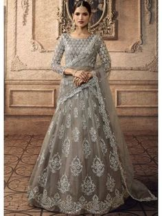 Grey net semi stitch lehenga with net choli. This lehenga choli is embellished with stone, sequins and dori work. Product are available in 32 to 58 sizes. It is perfect for Bridesmaid Wear, Guest of Wedding Wear, Party Wear, Wedding Wear. Lehenga Choli Online, Indian Lehenga, Silk Lehenga, Ghagra Choli, Bridal Lehenga Choli, Sharara, Braided Hairstyles Updo, Updo Hairstyle, Braided Updo
