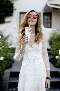 Chiara is wearing styligion dress, Varsity jacket,clutch&sunglasses....