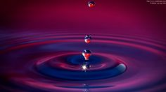 purple water | water drop hits surface of liquid, jet of water is collapsing (purple)