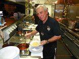 John Bongiovi, Sr. - father of rocker Jon Bon Jovi - prepared meals for approximately 60 people at JBJ Soul Kitchen in Red Bank on Monday night.