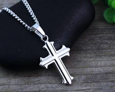 13//16 Inch Sterling Silver High Polished Cross Pendant with Etched Overlay Design