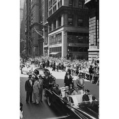 June 1, 1954: Ethiopian Emperor Haile Selassie waves to the crowd from the rear seat of his motorcade in New York City.