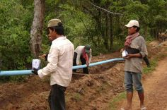 Villagers install a pipe system to bring water from the Chambok waterfall to the surrounding villages. Photo: Mlup Baitong/UNDP Cambodia