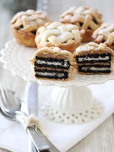 "15 Pies That Will Make You Sigh with Happiness | OREO & PEANUT BUTTER LAYERED LATTICE PIES | Proving that things are always better with Oreos, Jenny Flake of Picky Palate created these kid-friendly lattice ""pies"" that are just as easy to create as they are cute."