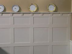 craftsman moulding painted white. love the moulding but would prefer it the traditional dark stain.