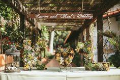 rustic wedding sign   Wedding Chicks Feature   John Robert Woods Photography   Rancho Las Lomas   24 carrots Catering