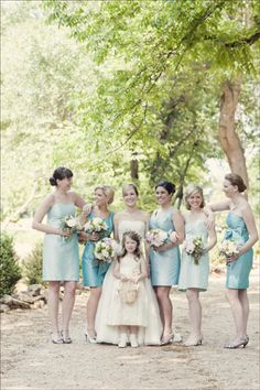 Bride and bridesmaids - mismatched blue dresses from Lula Kate