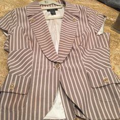 Short sleeve jacket Short sleeve crop jacket... One button closure... Button design on lapels and sleeves... Lined... Striped tan, cream, peach..Worn has tiny stain in front side... Not noticeable.. Look at last picture Arden B Jackets & Coats Vests