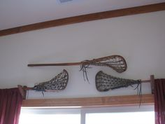 Lacrosse stick curtain rods. We have a vintage stick but won't be hanging curtains from it. : )