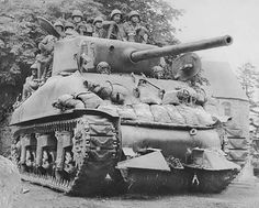 "A Sherman fitted with the ""hedge-cutter"" device, Normandy, 1944"