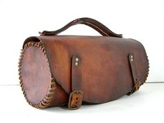 Fantastic leather tool bag with hand crafted detals and sewn by hand. Was perhaps handcrafted especially for a set of boules Lyonnaises (Lyon style