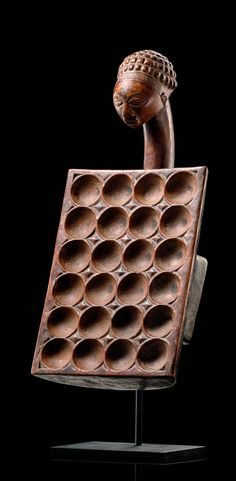Africa | Board game ~ mancala ~ from the Luba people of the Democratic Republic of Congo | Wood; mid brown patina with traces of black pigment