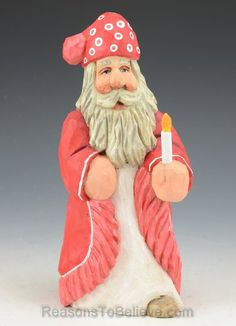 """Santa in his pajamas and holding a candle. A hand crafted Santa Claus figure, carved from solid wood. Designed, carved by hand, painted, fi..."