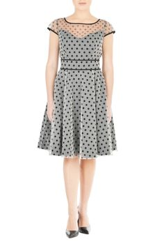 Sheer mesh with polka dot print envelops our romantic party dress creating a flattering feminine fit-and-flare silhouette.