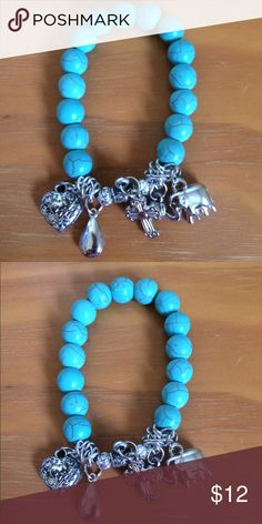 Charm bracelet stretchable. Includes 5 charms. Smoke free, cat friendly home. Please don't use my photos as it a reflection of my work. Thank you. haia Jewelry Bracelets