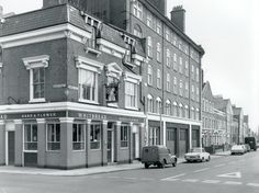photograph of Hand And Flower Pub, Parnell Road, 1970 London Pubs, Old London, Irish Catholic, East End London, London History, Far Away, London England, Old Photos, Multi Story Building