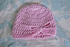I made this hat in white and trimmed it in pink for two baby girls born recently. Easy and very cute.