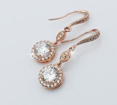 "CAMILA Collection   Cubic Zirconia Bridal Drop Rose Gold Earrings   Gorgeous Earrings are made with sparkling cubic zirconia crystals in rose gold plated settings   Earrings measure about 1 1/4"" long  Available in yellow gold, white gold, and rose gold plated finish   #wedding"