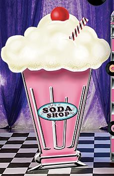 Brimming with balloons, this tasty cardboard and corrugated milkshake makes a great photo setting at your 1950s bash!