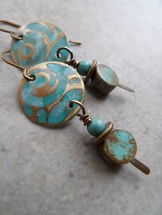 Azteca ... Patinaed Brass Charms, Turquoise and Brass Wire-Wrapped Earrings by juliethelen on Etsy https://www.etsy.com/listing/202923241/azteca-patinaed-brass-charms-turquoise