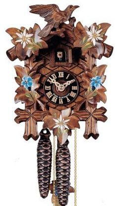 """Hones 8.5"""" 1 Day Carved 100ENZ Cuckoo Clock- Meticulously etched, this clock is rightfully a piece of incredible artwork. It features the three signature animals of the Black Forest; deer, bird and rabbit. It also has leaves and branches woven into the architecture. It also features traditional dancers that one might have seen during the dawn of cuckoo clocks. You are guaranteed a Black Forest Seal with the purchase of this.  Designed in Time"""