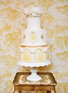 """A cake created by Amber from """"Sweet on Cake"""" is the masterpiece that finishes a wedding with a note of bliss. Nothing says """"I want to make a home with You"""" better than a cake that is inspired by the architecturally structure of a wedding space"""