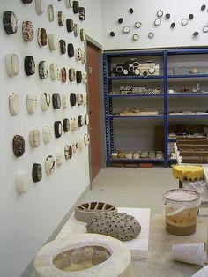 Studio, interesting ceramic relief sculptures on walls