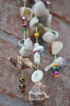 Seashells, buttons, beads ... make a wind chime :)