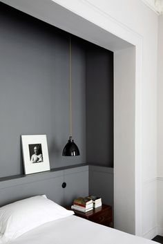 Great Headboard Shelving and dark gray to go with white bedroom walls and white bedding.