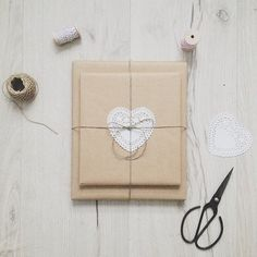 brown paper, a doily and wrapped with twine. Simple, clever and very pretty