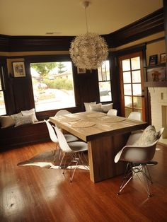 like the contrast of the wooden table with the white chairs