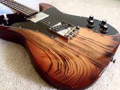 Fender Guitar American '72 Telecaster Custom Vintage Reissue in Sienna burst with solid brass compensated bridge saddles.