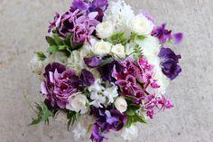 Sophisticated Floral portland oregon wedding florist purple bridal bouquet spring flowers mini purple phalaenopsis orchids, spray roses, hyacinth, mint, hydrangea, sweet peas and jasmine vine