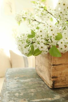 FInd a mini crate, and place your vased flowers inside. Instant rustic.