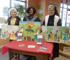 "-Jessicah Peters/The Sun Today Booksalicious owner Judy Hutson, Reverend Gwendolyn Green and Sister Pamela Smith, author of ""How Jonathan Green painted my momma"" stand with an array of Green's paintings. Smith and Green joined together to showcase their creative talent in depicting the Gullah history on Saturday at Booksalicious."