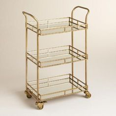 Affordable gold & mirrored bar cart for a sale price of $119, such a steal - if you sign up for the Cost Plus Explorer Rewards account you can get free shipping or 15% off taking the price down to $100! The only glamorous gold bar cart I've seen for $100! Gold Cole 3-Tier Rolling Bar Cart | World Market