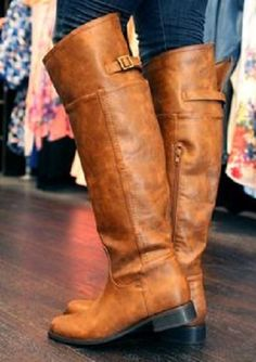 tall, honey colored riding boots with back buckle