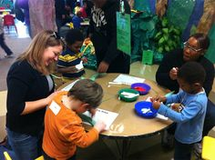 """A new pilot scholarship program provided kindergarten students and parents from Milwaukee Public Schools' 81st Street School the chance to take an interactive """"Chameleons and Snakes"""" Zoological Society of Milwaukee class on Tuesday."""